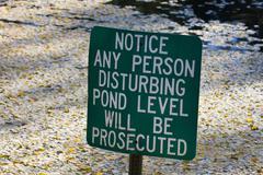 do not disturb pond level. - stock photo