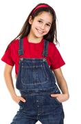 Smiling girl in coveralls Stock Photos