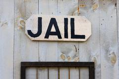 An old-fashioned western jail sign Stock Photos