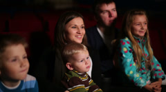 Stock Video Footage of Children and adults watch family comedy at the cinema