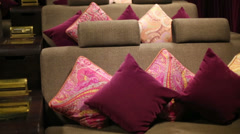 Soft sofa with colorful cushions in cinema theatre Stock Footage