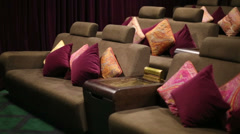 Soft sofa with colorful cushions in VIP cinema hall Stock Footage