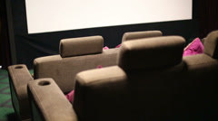 Hall with screen and soft sofas in cinema at GUM Stock Footage