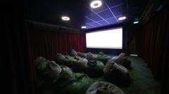 Film trailer in children movie hall with soft ottomans in cinema Stock Footage