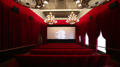 Big red hall and screen with titers in cinema at GUM Stock Footage
