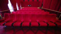 View from screen to hall with red seats in cinema at GUM Stock Footage