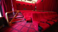 Slow review big hall with red seats and stairs in cinema Stock Footage