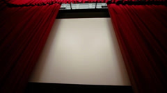 Automatic opening tall beautiful red curtain in cinema theater - stock footage