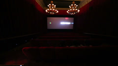 Movie trailer on screen in dark cinema hall at GUM Stock Footage