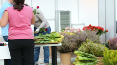Women makes rose bouquets at XIX International Flower Show Stock Footage