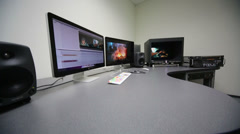 Table with monitors in equipment room for post-synching editing Stock Footage