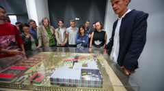 Young producer Ilya Bachurin shows layout of new cinema complex Stock Footage