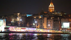 Illuminated Galata Bridge with reflection in water Stock Footage