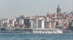 Daytime movement of passenger ship and traffic in Istanbul Stock Footage