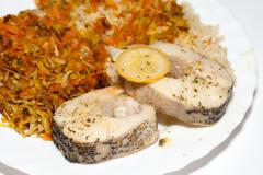 the healthy diet - brown rice with fisch and vegetable - stock photo