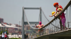 Mother with children standing on the bridge in Istanbul, Turkey. Stock Footage