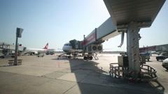 Airplane near terminal in Ataturk International Airport Stock Footage