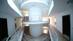 Hotel foyer with white wall and a spiral staircase Stock Footage