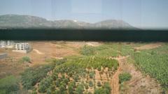 Descent by elevator overlooking the gardens in Mahmutlar Stock Footage