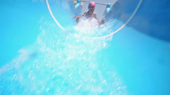 One girl in the cap for the pool rolls on blue waterslide Stock Footage