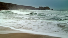 A big sea breaking onto the sandy beach in Cornwall Stock Footage