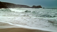 Stock Video Footage of A big sea breaking onto the sandy beach in Cornwall