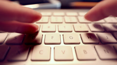 Personal perspective of typing on keyboard. Stock Footage