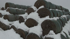 AERIAL - Round Bale Hay Stacks With Snow Stock Footage