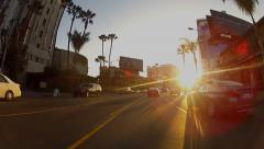 Driving Into Sunset On Sunset Boulevard- West Hollywood, CA Stock Footage
