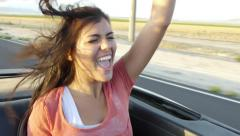 Teen Girl Sings And Dances In The Backseat Of Convertible Stock Footage