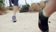 Woman running trail close up shoes steadicam shot Stock Footage