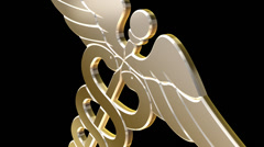Close Up of Gold Caduceus Medicine Logo Rotating Stock Footage