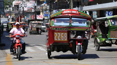 Tricycle motor taxi, Philippines Stock Footage