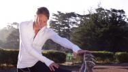 Stock Video Footage of Personal Fitness - Young Woman Stretches before Run