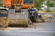 Stock Photo of closeup skid steer loader excavator at road construction work