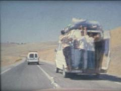 SUPER8 MOROCCO driving a 1970's Mercedes on the road 4 Stock Footage