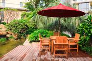 Stock Photo of Summer Patio with tables and wooden chairs