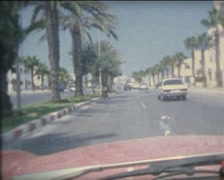 SUPER8 MOROCCO driving a 1970's Mercedes on a Tangier boulevard - stock footage