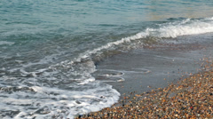 Water waves on the rocky shore of the black sea Stock Footage