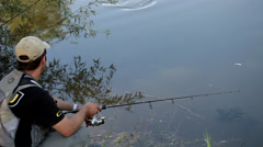Sport fisherman fishing on a river Stock Footage