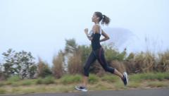 woman running on road close up shoes steadicam shot - stock footage