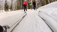Stock Video Footage of a family cross country skiing after a snow storm low shot