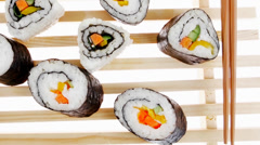 Roll with Cucumber  Cream Cheese with raw Tuna and Salmon insid Stock Footage