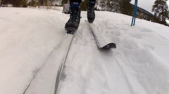 a cross country skiing low shot - stock footage