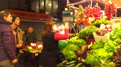 Buying fresh vegetables in market Stock Footage