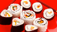 Stock Video Footage of Japanese Cuisine : Sushi Maki Roll on red plate
