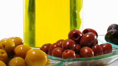 Olive oil in glass bottle with olives Stock Footage