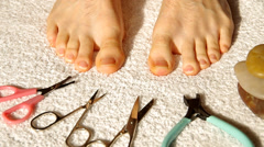 Toenails and scissors Stock Footage