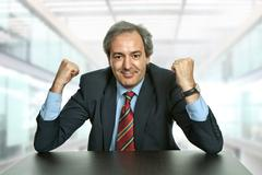 business man with open arms at the office - stock photo