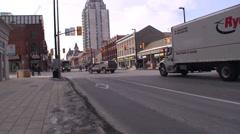 Trucks driving through a down town main street. Stock Footage